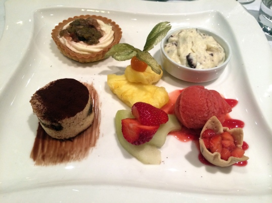 Strawberry rhubarb tart, rum pudding, raspberry sorbet, strawberry cup, fresh fruit, and Tiramisu (clockwise from top)