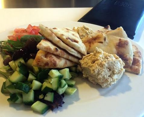 Hummus, Kalamata olives, cucumbers, tomatoes and mixed greens, with warmed pita points.