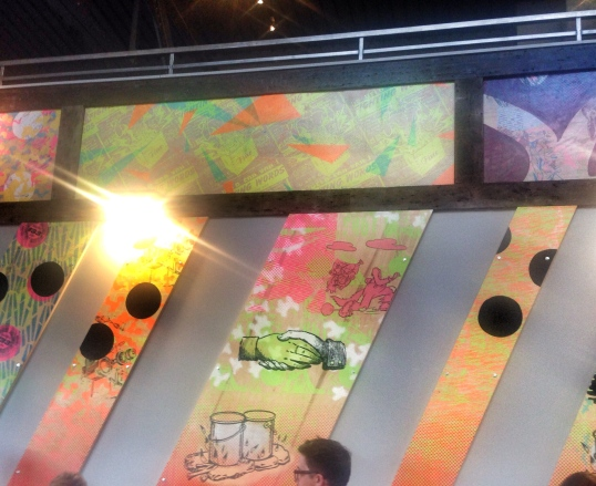 Bright, colorful art hangs all around the restaurant.